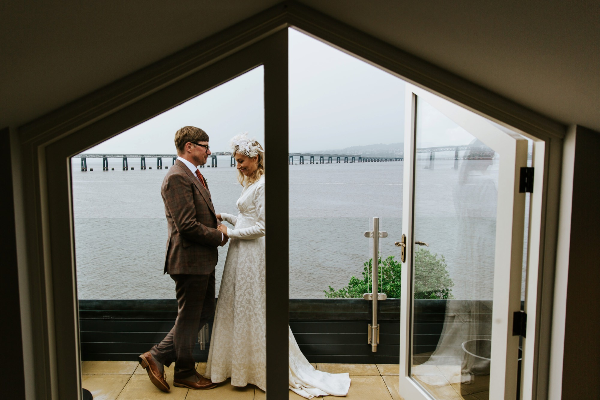 bride and groom on balcony overlooking the Tay Bridge, Fife